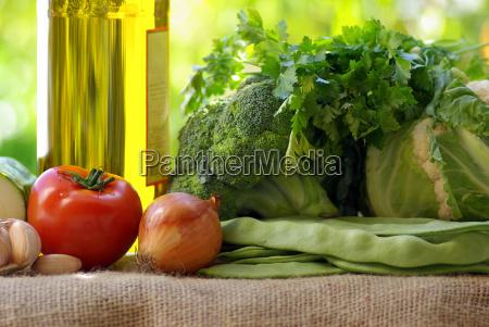 bottle of olive oil and vegetables