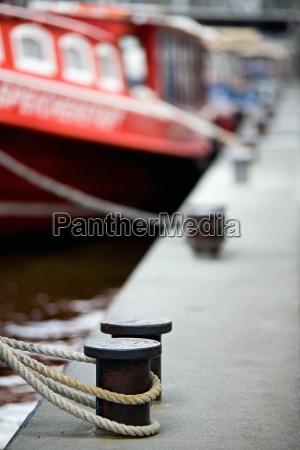 boats docked in harbor bollards