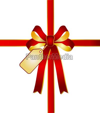 geschenkschleife mit goldener grusskarte