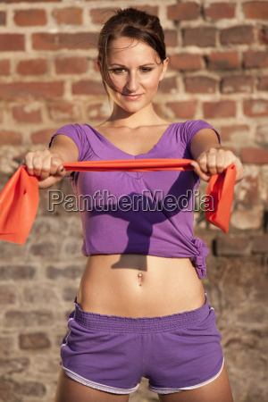 fitness girl with ribbon