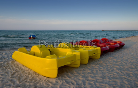pedal boats on the beach