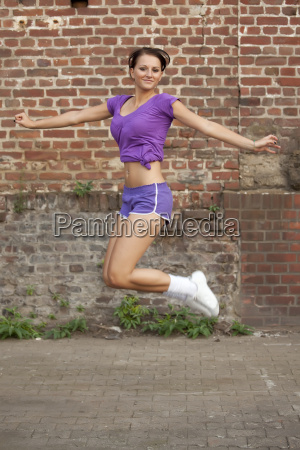 fitness woman jumps