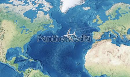 weisses zivilflugzeug ueber dem atlantik