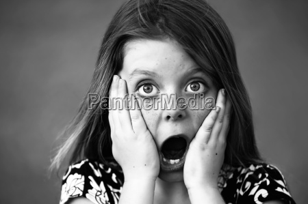 pretty young girl with a shocked