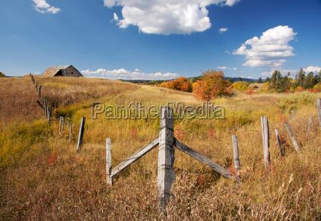 beautiful fall landscape with rustic barn