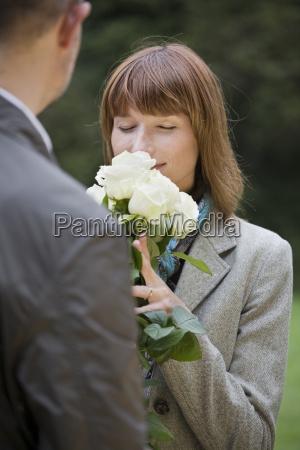 woman reporting of roses