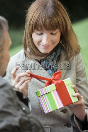 woman opens a gift box