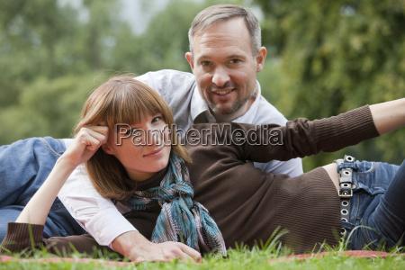 portrait of couple in park