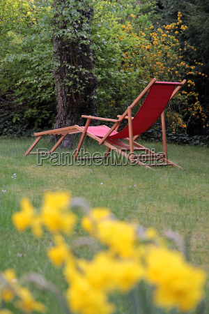 red deck chair in the garden