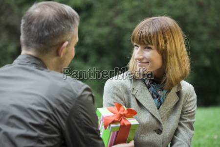 male with gift box for woman