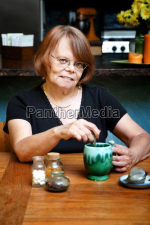 senior woman drinking herbal tea