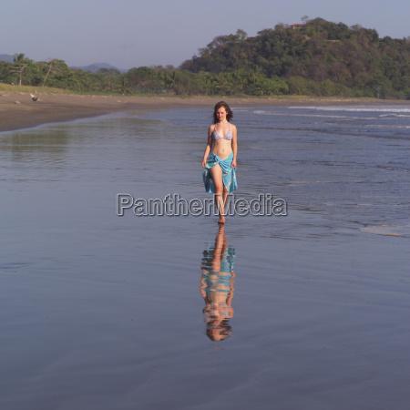 teenage girl walking through water