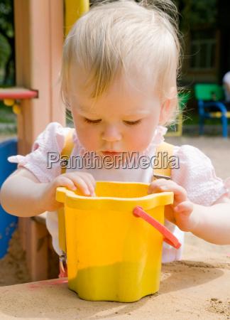 little girl in a sandbox