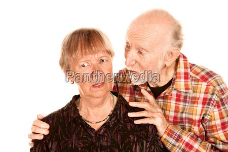 senior man sharing information with concerned