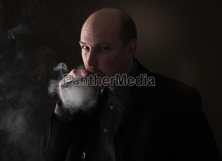 cigar smoking man