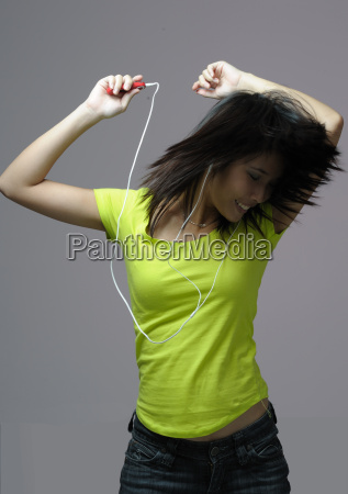 young woman dancing to music mp3