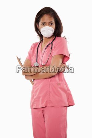 attraktive dreissigerjahre asiatische frau arzt krankenschwester