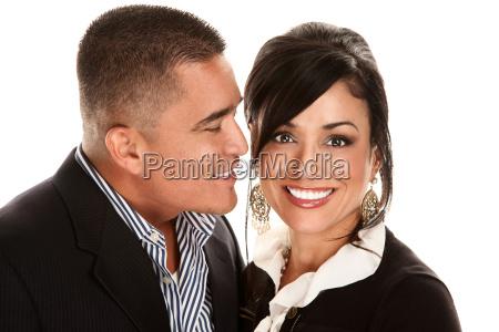 hispanic man kissing latina woman