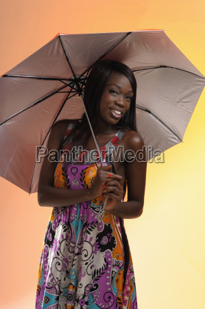 spirited african woman with umbrella