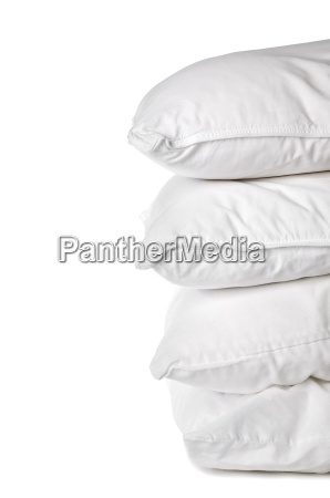 a stack of 4 white pillowcases