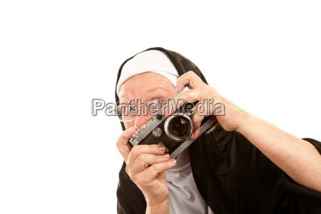 funny nun with camera