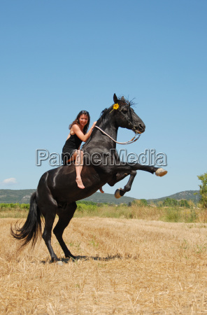 girl and rearing horse