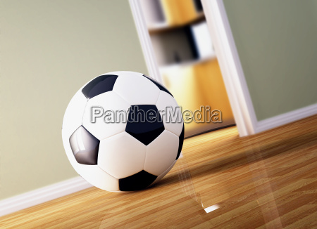 soccer ball on wood floor