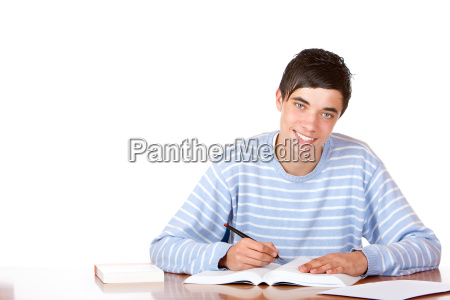 young happy handsome male student sitting