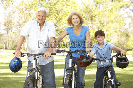 grandparents and grandson on cycle ride