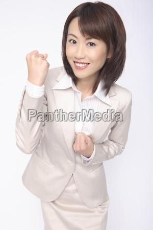 business lady clenching fist in triumph