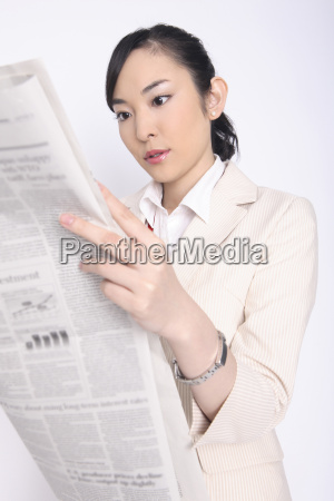 business lady reading a newspaper