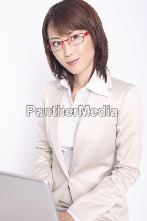 business lady operating a laptop computer