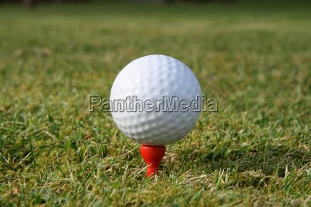 a golf ball on a red