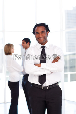 confident african businessman smiling at the