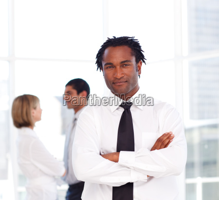 african businessman with folded arms