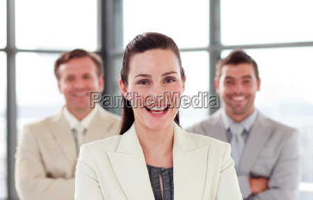 smiling businesswoman with folded arms in