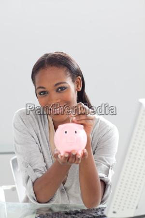 confident ethnic businesswoman saving money in