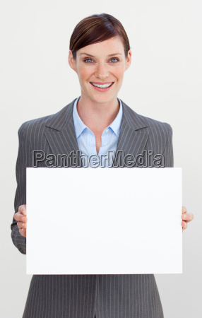 smiling businesswoman holding white card