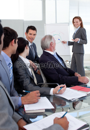 smiling manager giving a presentation to