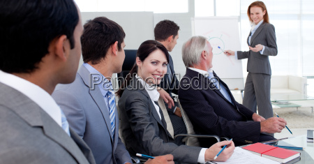 businesswoman reporting sales figures to her