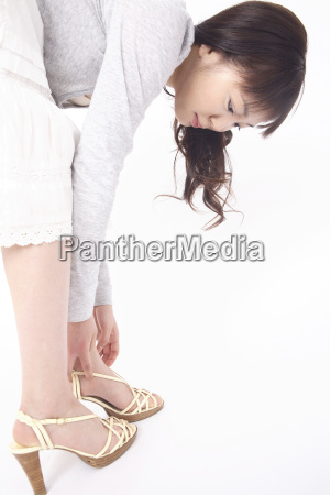 japanese woman putting on shoes