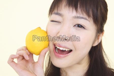 japanese young woman having a lemon