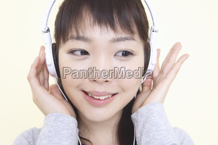 japanese woman listening to the music