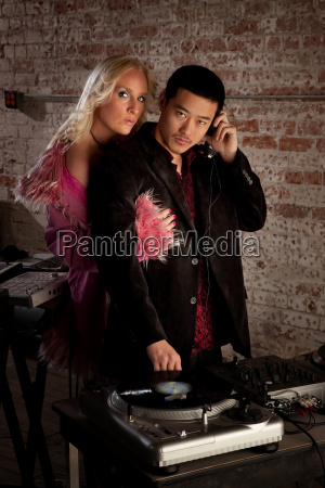 asian dj with blond woman at