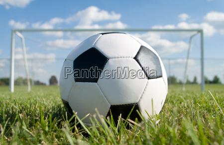 football against the goal net