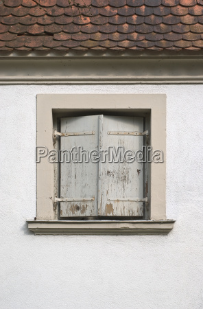 window with shutters on a house