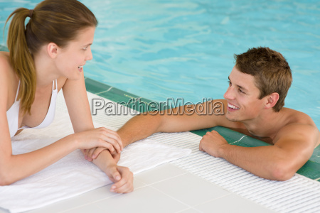 swimming pool young loving couple