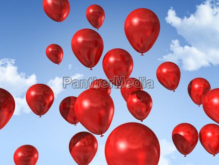 rote luftballons auf einem blauen himmel