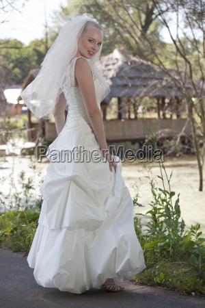 happy bride posing outdoor