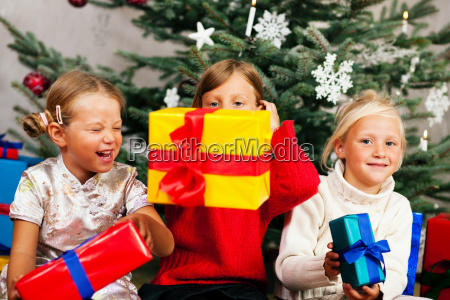 christmas children with presents